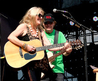 Neil Young joins wife Pegi Young onstage at Farm Aid 2012 / photo credit: Maria Ives